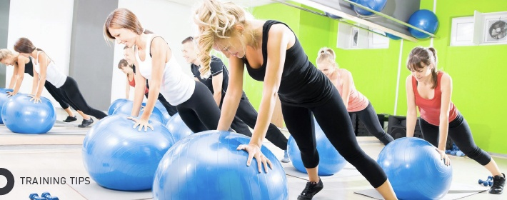 Exercise class with balance balls
