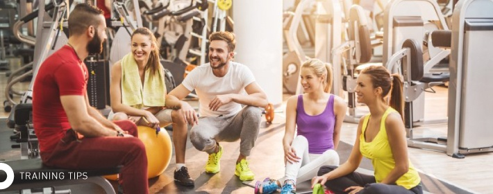 Friends in gym for training tips