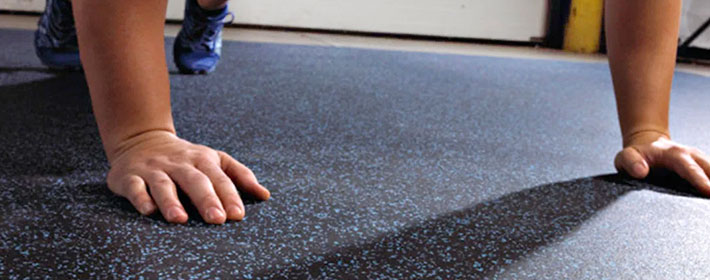 Man doing push ups on rolled rubber flooring from Zogics.