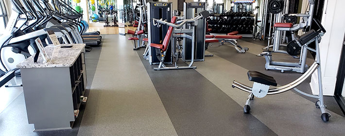 Rolled rubber flooring in a gym.